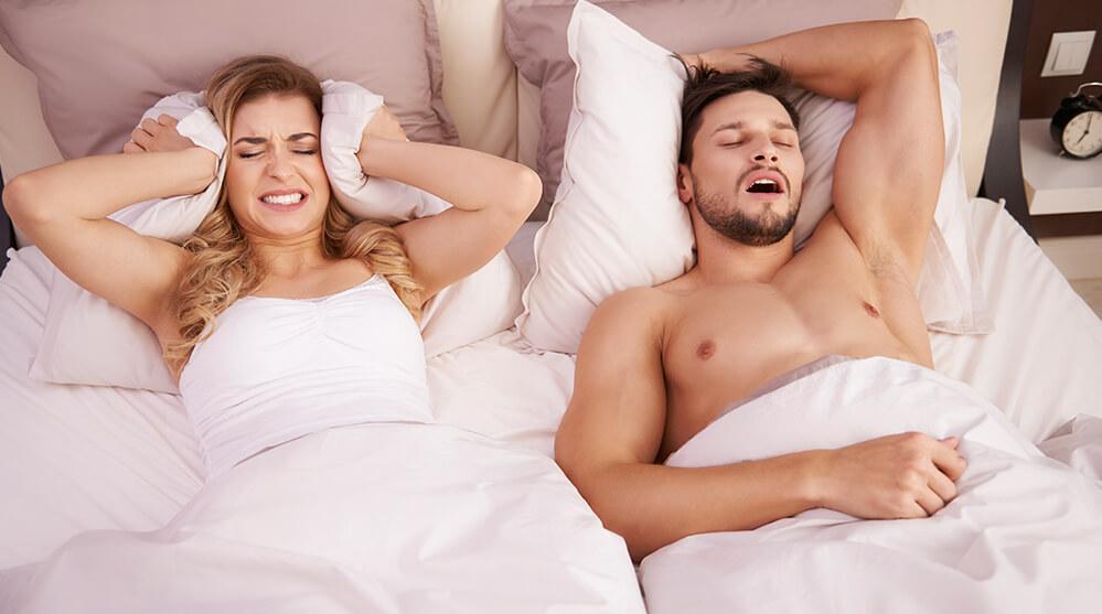 snoring man beside woman
